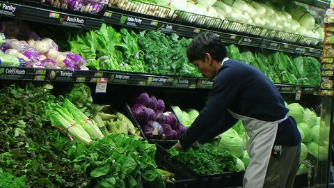 Man Facing Lettuce In Produce Stock Video Footage
