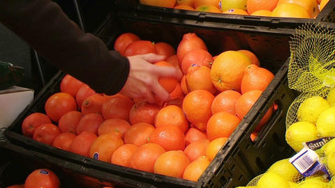 Woman Selecting Oranges In Produce Footage
