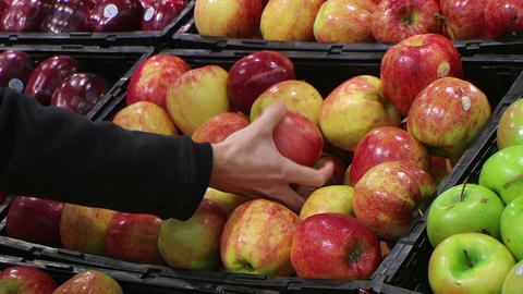 Woman Selecting Apples In Produce Footage