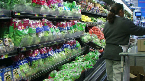 Woman Stocking Lettuce In Produce Stock Video Footage
