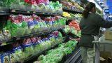 Woman Stocking Lettuce In Produce stock footage