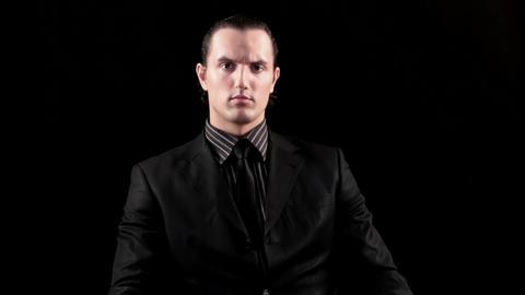 businessman speaking on black background Stock Video Footage