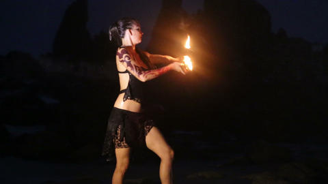 Artist turns the fire palm torches performance Footage