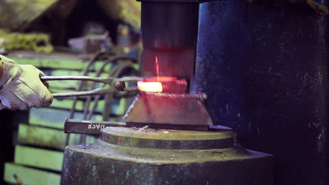 farrier is forging a horseshoe Footage