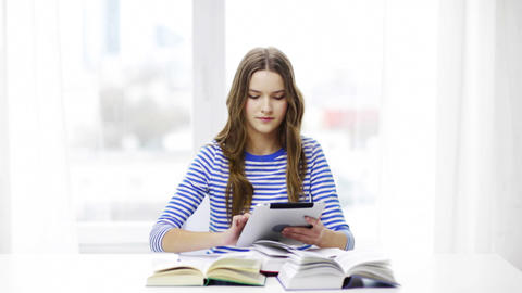 smiling student girl with tablet pc and books Footage