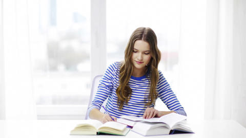 happy smiling student girl with books Footage