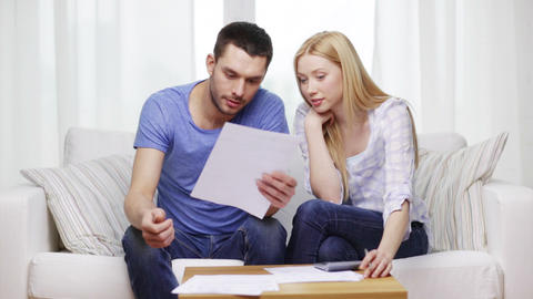 busy couple with papers and calculator at home Footage