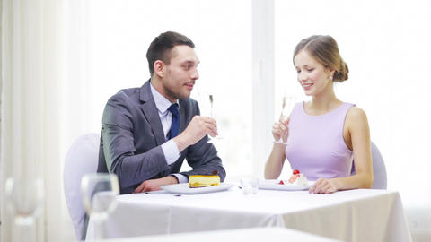 Smiling Couple With Champagne At Restaurant stock footage