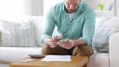 man counting money and making notes at home Footage