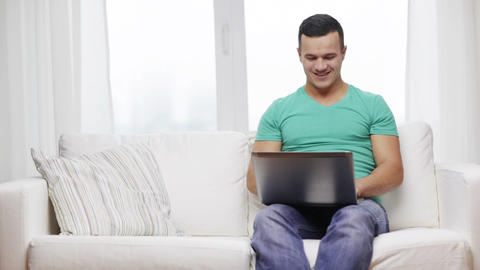 smiling man working with laptop at home Footage