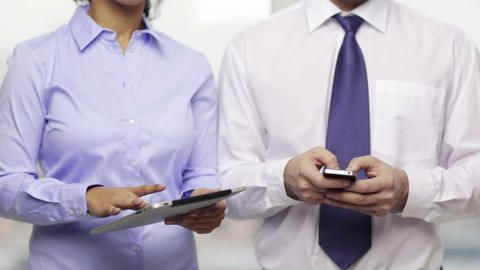 two businesspeople with smartphone and tablet pc Footage