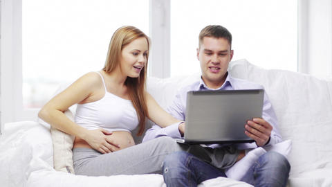 happy family looking with laptop computer Footage