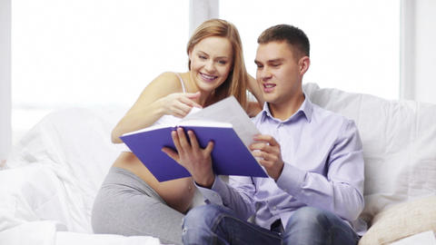 Happy Family Reading Book At Home stock footage