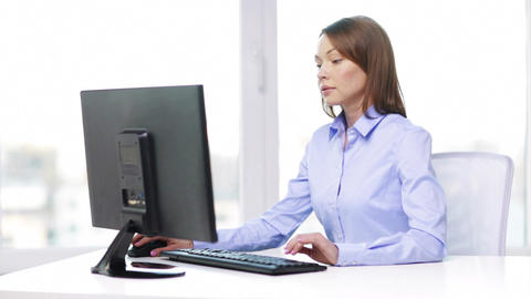 busy businesswoman with computer in office Footage