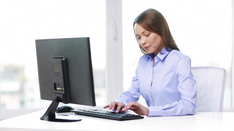 smiling businesswoman with computer in office Footage