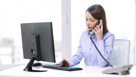 busy businesswoman with telephone and computer Footage