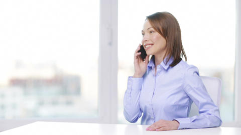 smiling businesswoman with smartphone in office Footage
