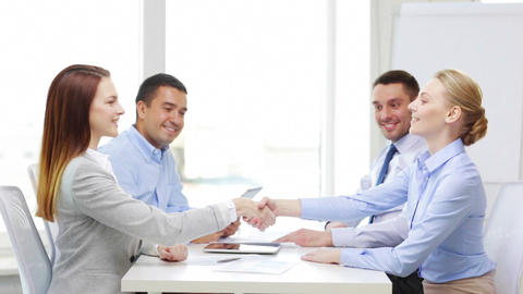 smiling team with table pc working in office Footage