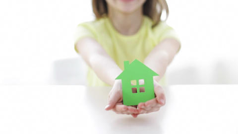close-up of smiling girl holding paper house Footage