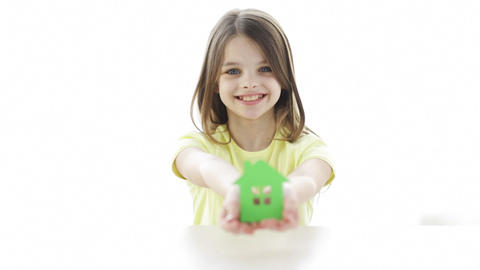 smiling girl holding paper house Footage