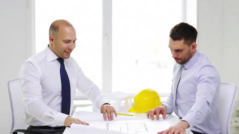 two smiling businessmen or architects in office Footage
