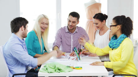 Smiling Fashion Designers Working In Office stock footage