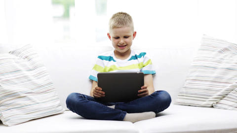 smiling boy with tablet pc computer at home Footage
