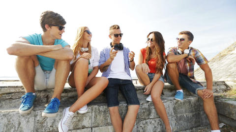group of smiling teenagers hanging out outdoors Footage
