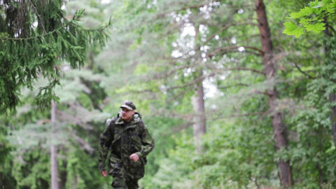 young soldier with backpack in forest Footage