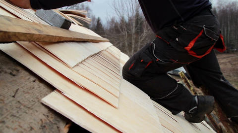 Roofer wearing work clothes cedar wooden shingle s Footage