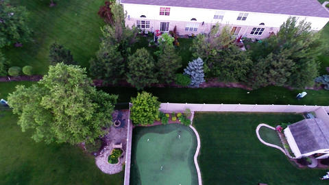 Aerial view of backyard putting green from in air Footage
