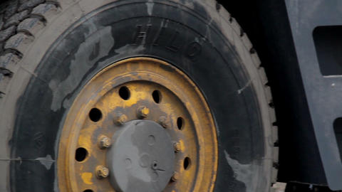 Tires of the heavy equipment machine are dirty Footage