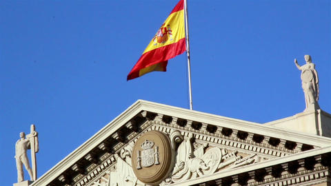 Flag Of Spain On Top Of Building stock footage