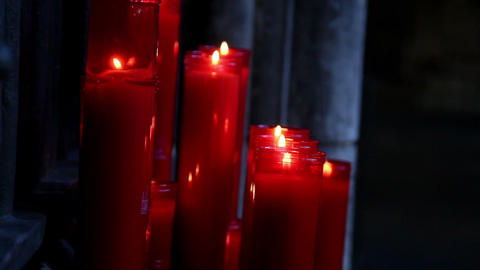 Lighted red candles in a dim-lighted place in chur Footage