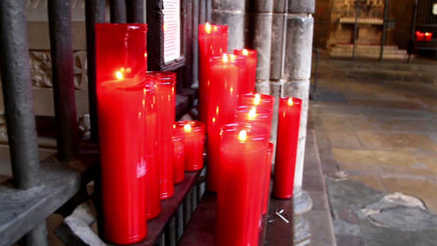 Pile of lighted red candles in church Footage