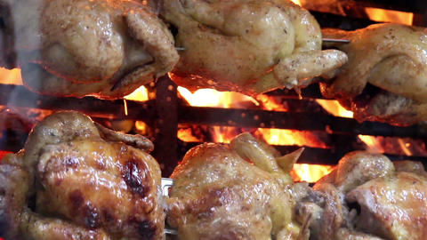 Juicy Whole Roasted Chickens On Flames stock footage