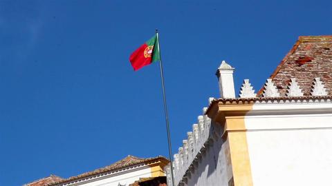 Waving Portugal flag on a blue sky Footage