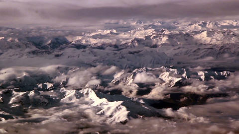 Clouds above rocky mountains thin clouds and the w Footage