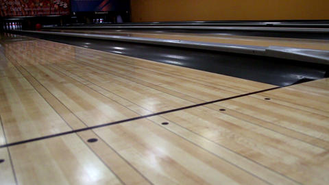 Red bowling bowl set to hit the pins Footage