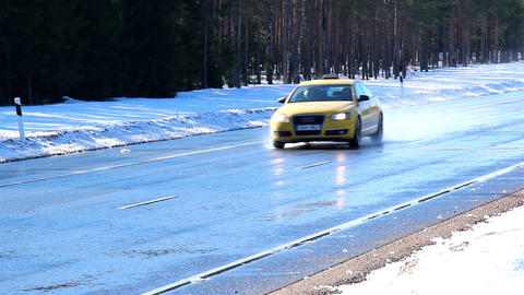 A road with thick snow covering the side road Footage