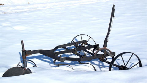 Old agri tool stuck on the snow Footage