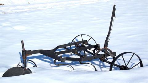 Old agri tool stuck on the snow Footage