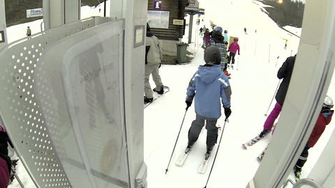 A hand releases the bar on ski Footage