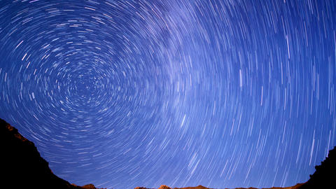 Stars line over the mountains. Time Lapse. 4K Footage