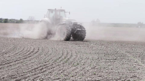 Tractor plowing the black earth plow field Footage
