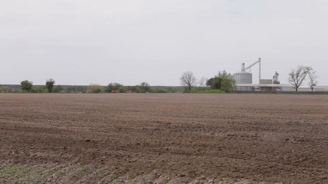 Car Driving On A Road Plowed Field Of Granaries stock footage