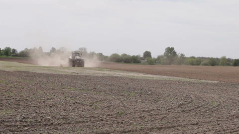 Tractor Plowing The Black Earth Plow Field stock footage