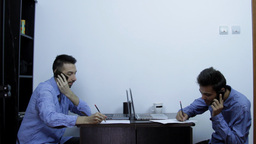 Young Business Men Talking On The Phone And Writin stock footage