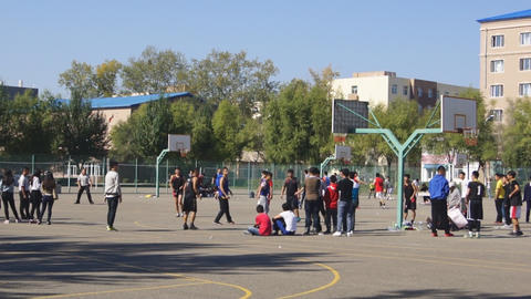Chinese Students Play Basketball Outdoors 02 stock footage