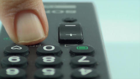 Finger Touching The Channel Button On A TV Remote, Footage